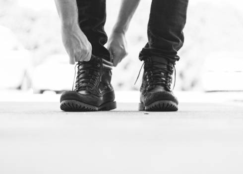 Person Wearing Black Leather Boots Free Photo
