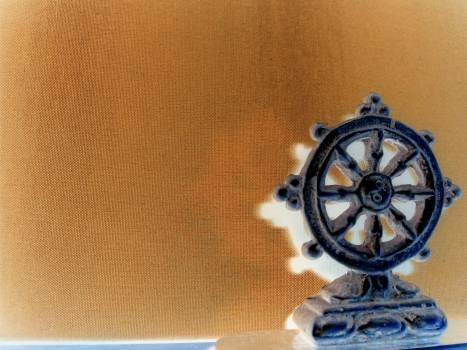 Buddhist wheel wallpaper - free stock photo #400987