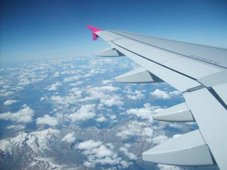 The clouds and wing from the aircraft - free stock photo #401135