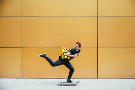 Skateboarder on Sidewalk Free Photo #401621
