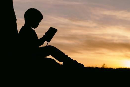Silhouette Child Reading Sunset Free Photo Free Photo