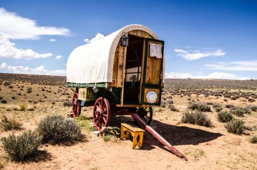 A Traditional Caravan Rests Under Blue Skies In The Plains #405673
