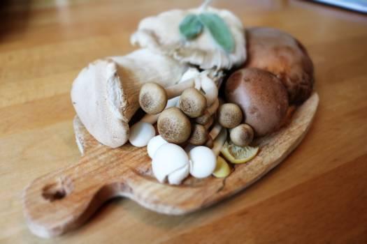 Mushroom on Brown Wooden Plate #40587