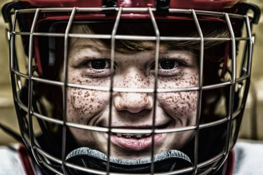 Boy With a Football Helmet Smiling #40646