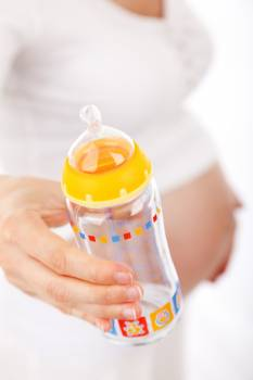 Baby's Feeding Bottle on Hand Free Photo
