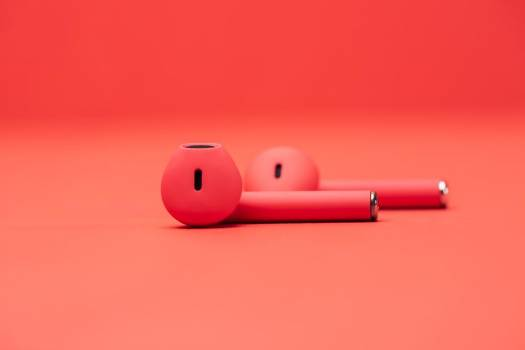 Pair of Red Earbuds On Red Surface #407869