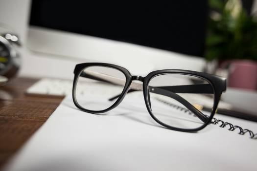 Close- up of reading glasses on office desk #408735