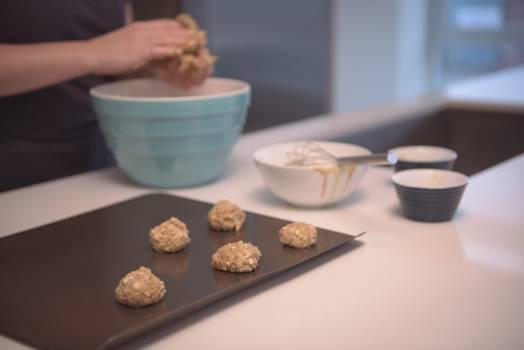 Midsection of baker preparing cookies #408774