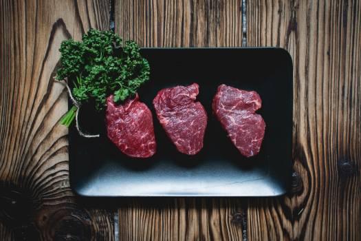 Raw beef steaks #409119