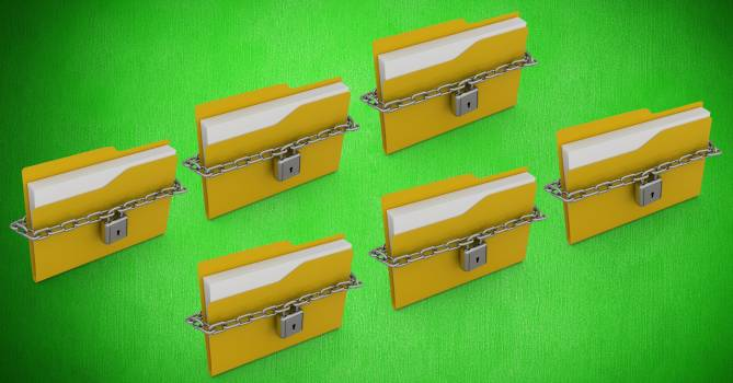 File folder with chain locked against green background Free Photo