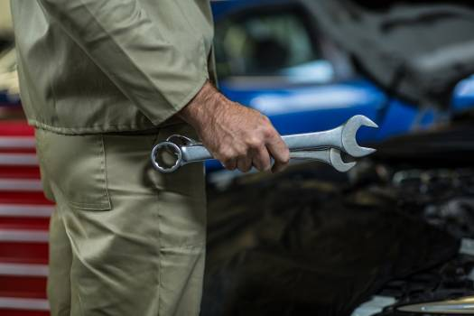 Mid-section of mechanic holding wrench tool #409451