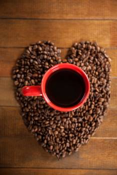 Coffee cup with heart shaped coffee beans #409458