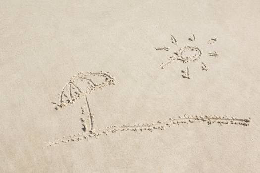 Sun and umbrella drawn on sand #409595