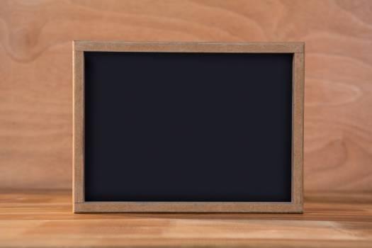 Blank chalkboard on a table #409599