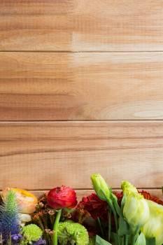 flowers arranged on wooden board #409649