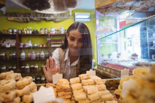 Woman looking at turkish sweets in shop #409650