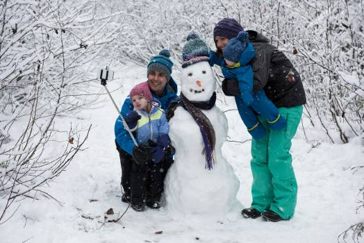 Family taking selfie with snowman #409656