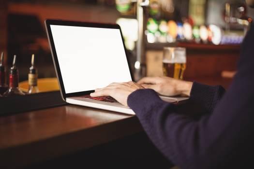 Close-up of man using laptop Free Photo