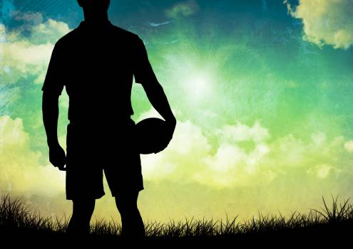 Silhouette of athlete holding rugby ball #409693