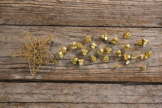 Christmas bells and star on wooden plank #409703