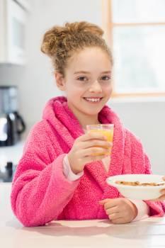 Cute girl having breakfast in kitchen #409711