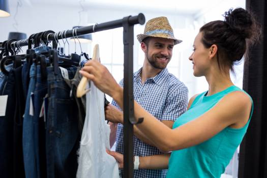 Couple choosing clothes from clothes rack #409749