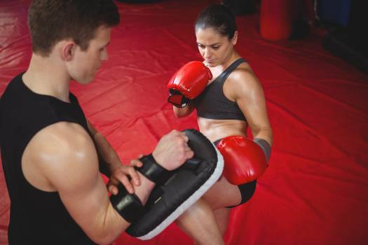 Female boxer practicing with trainer #409751