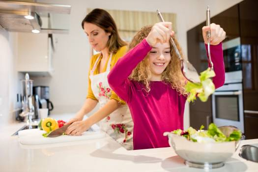 Mother and daughter working in kitchen Free Photo