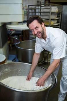 Smiling baker mixing flour #409825