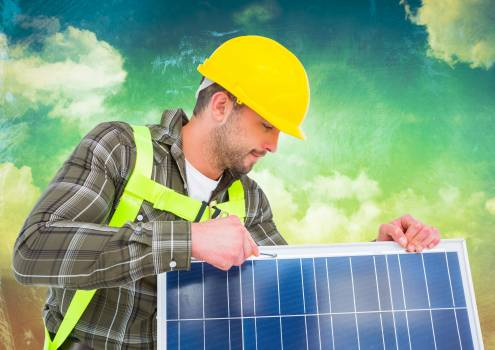 Man in hardhat holding a solar panel #409876