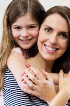 Portrait of mother and daughter embracing each other Free Photo
