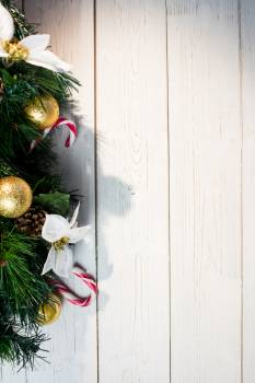 Christmas decorations on wooden plank #409909