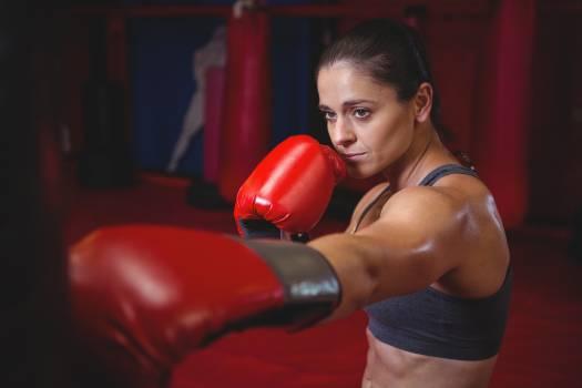 Female boxer punching a boxing bag #409911