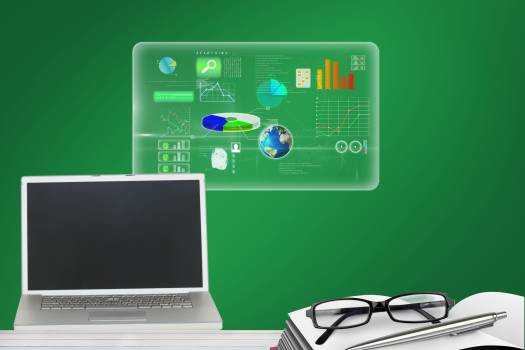 Laptop with interface in green background #409919