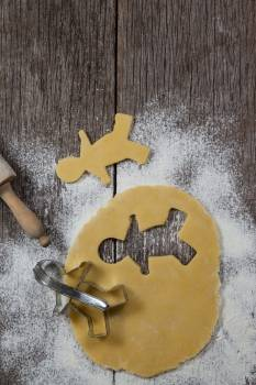 Dough with gingerbread shape and cookie cutter #409996