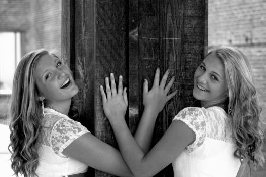 Two Women Wearing White and Lace Tops Smiling Free Photo