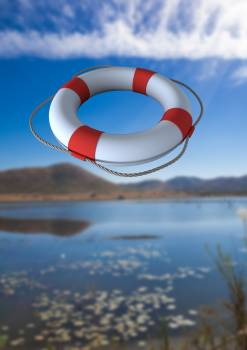Composite image of lifebuoy with rope in mid-air #410014
