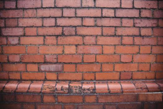 Modern brick wall background #410017