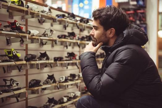 Man selecting ski binding in a shop #410028