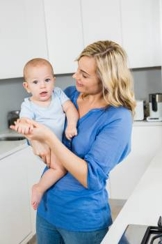 Mother holding her baby boy in kitchen #410032