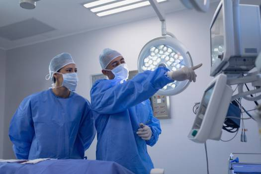 Surgeons performing surgery in operation theater #410056