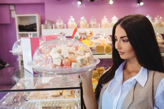 Woman looking at turkish sweets in shop #410148