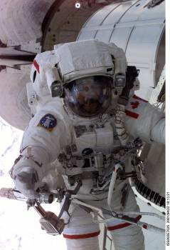 View of STS-100 MS Hadfield during EVA 1 #410174