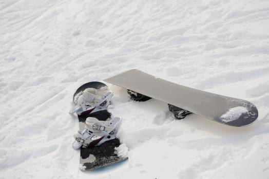 Snowboard on snowy slope in ski resort #410177