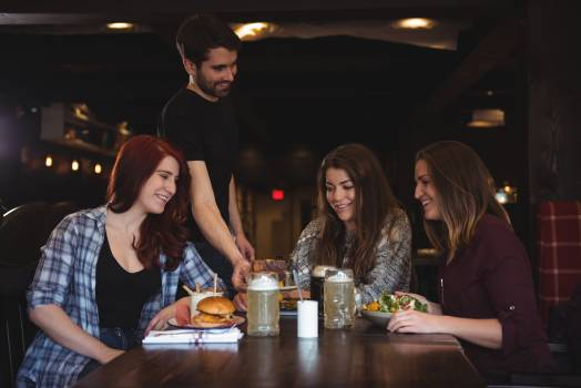 Friends having food in bar Free Photo