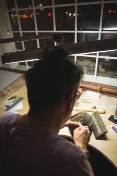 Craftswoman working in workshop Free Photo