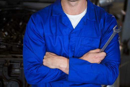 Mechanic standing at repair garage #410261