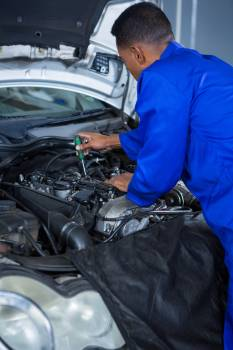 Mechanic servicing a car engine #410266