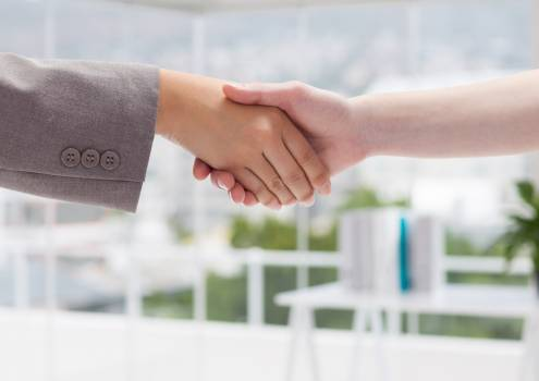 Business executives shaking hands at office workplace #410267