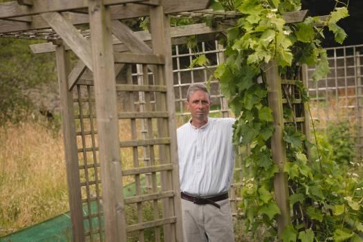 Senior man standing in the garden #410270